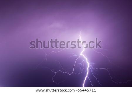 bolt of light cutting night sky - stock photo