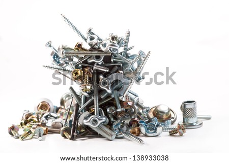 Bolts, screws, nails, nuts, washers, rivets on white background