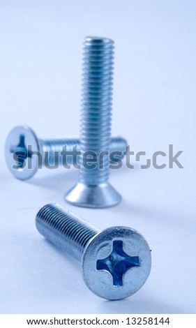 Bolts, screws, nuts. In a blue tonality