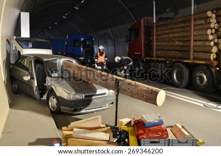 BOLZANO, ITALY - APRIL 5, 2015: A car destroyed by a fallen tree trunk due to a heavy truck. Fatal accident ended with a tree inside a car in the gallery of a freeway on April 5, 2015