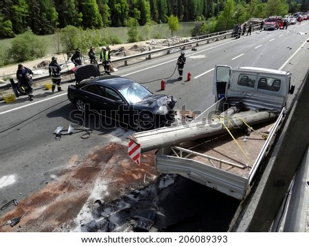 BOLZANO, ITALY - MAY 6, 2013: Fatal motorbike car crash accident after a  frontal collision between two cars on the road with intervention of paramedics and firefighters on May 6, 2013