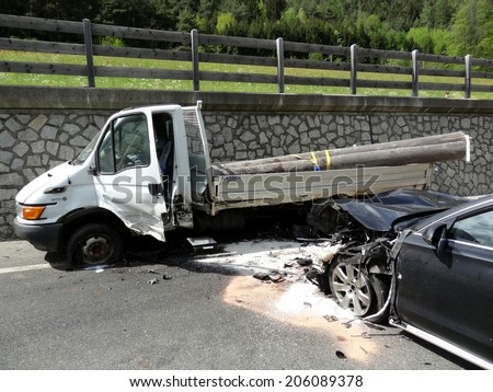 BOLZANO, ITALY - MAY 6, 2013: Multiple car crash accident after a frontal collision between two cars and Van on the road in Bolzano on May 6, 2013 - stock photo