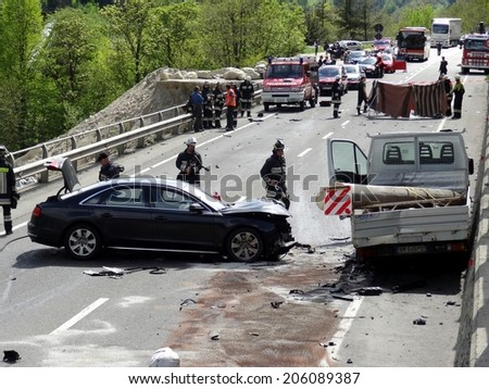BOLZANO, ITALY - MAY 6, 2013: Multiple car crash accident after a frontal collision between two cars and Van on the road in Bolzano on May 6, 2013 with intervention of paramedics and firefighters
