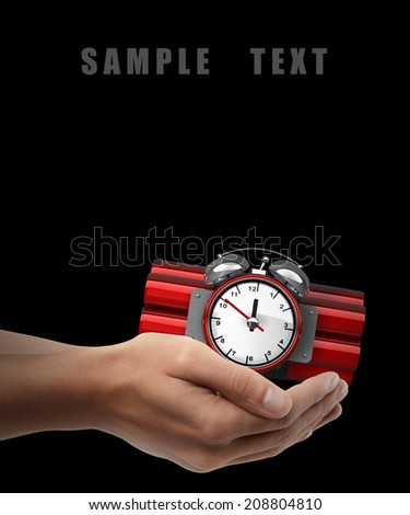 Bomb with clock timer. Man hand holding object isolated on black background. High resolution  - stock photo