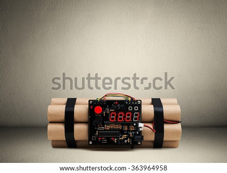 bomb with timer on the floor in room - stock photo