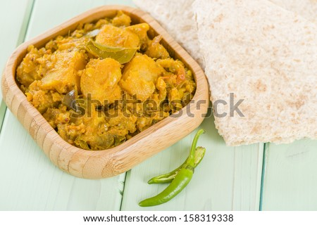 Bombay Aloo - Spiced potatoes served with chapatis. - stock photo