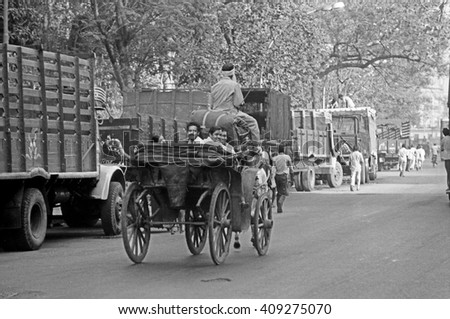 BOMBAY, INDIA - FEBRUARY 15, 1984: traffic and pedestrian in one of the city main street. The place is every day extremely crowded. - stock photo
