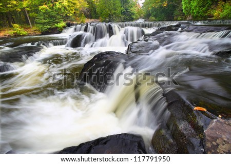 Bond Falls flows through the forests of northwoods Michigan - stock photo