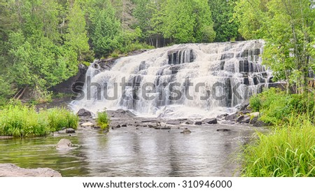 Bond Falls reflection, on the Middle Branch of the Ontonagon River, near Bruce Crossing, Michigan. - stock photo