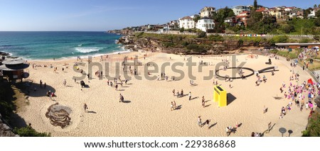 BONDI, AUSTRALIA -  NOVEMBER 9, 2014; Sculpture by the Sea free public event 2014.  Overhead view of some of the sculptures on Tamarama Beach, during the annual Sculptures by the Sea festival. - stock photo
