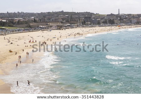BONDI, AUSTRALIA - OCTOBER 17, 2015: People swimming and sun bathing at Bondi Beach, Sydney