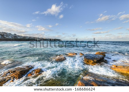 Bondi Beach, Sydney during wintertime as the sun is setting. - stock photo