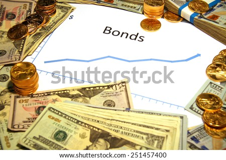 bonds chart graph going up rising with money and gold  - stock photo
