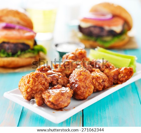 boneless barbecue chicken with burgers and beer - stock photo