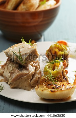 Boneless chicken marinated in garlic and oregano sauce with grilled vegetables closeup