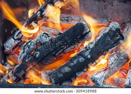 Bonfire and embers close-up. - stock photo