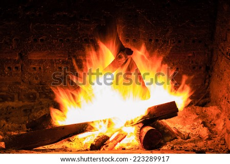bonfire and flames in a fireplace