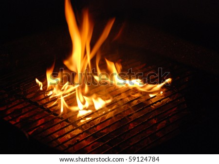 Bonfire background with fire flames and firewood - stock photo