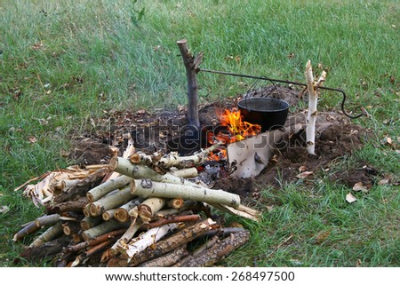 Bonfire / Cooking dinner in field conditions at the bonfire - stock photo