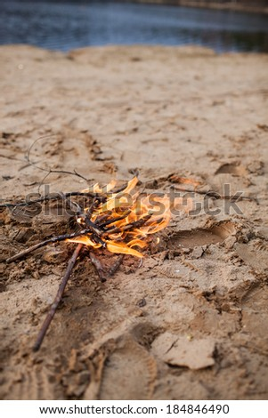 bonfire on the beach - stock photo