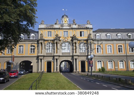 Bonn, Germany - August 30, 2013: Road with traffic of cars passes through the gate of the historical building of Bonn University in Bonn, Germany - stock photo