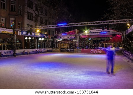 BONN, GERMANY - DECEMBER 11: Ice skate rink at Christmas market on December 11, 2012 in Bonn, Germany. There are 170 stalls at this market. - stock photo