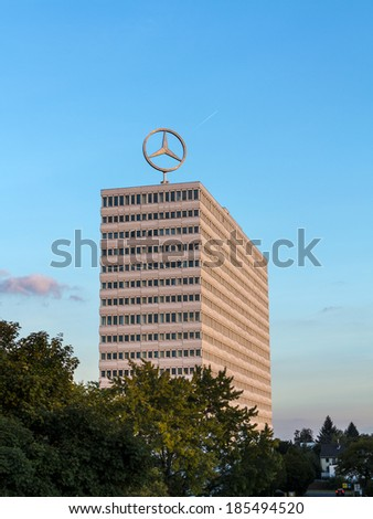 BONN, GERMANY - SEP 21: image of the Mercedes Benz logo on the rooftop of a high rise building on Sep 21, 2012 in Bonn, Germany. Mercedes-Benz is a German automobile manufacturer