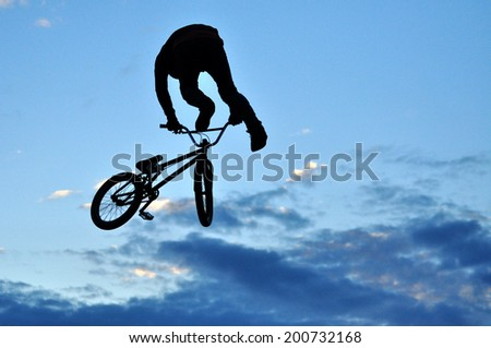 BONTIDA - JUNE 19: Unidentified BMX rider making a bike jump during the BMX Competition, at Electric Castle Festival on June 19, 2014 in the Banffy castle in Bontida, Romania