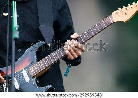 BONTIDA, ROMANIA - JUNE 28, 2015: Guitarist on stage during a live concert at Electric Castle festival, one of the biggest music festivals in Romania. - stock photo