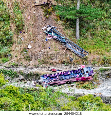 Bontoc, Mountain Province, Philippines - Feb. 27, 2014: Florida Trans bus falls off mountain road in Paggang, Talubin, Bontoc on Feb. 7, 2014, killing 14 people and injuring more than 32 others. - stock photo