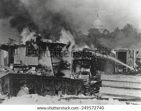 Bonus Army shacks on fire at Anacostia flats, Washington, D.C. Army troops broke up the Bonus Marchers protest and burnt their shanty town on July 29, 1932. - stock photo