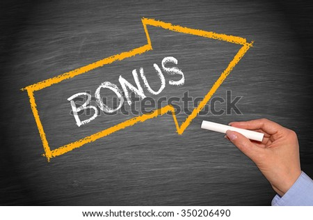 Bonus arrow with text on chalkboard background with female hand and chalk - stock photo