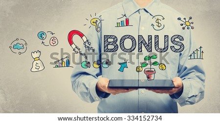 Bonus concept with young man holding a tablet computer  - stock photo