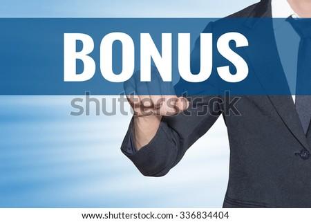 Bonus word Business man touching on blue virtual screen - stock photo