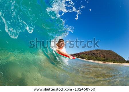 Boogie Boarder Surfing Amazing Blue Ocean Wave - stock photo