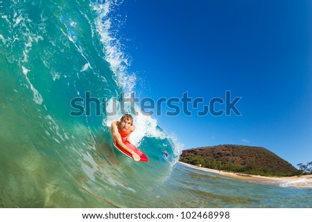 Boogie Boarder Surfing Amazing Blue Ocean Wave - stock photo