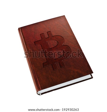 Book about bitcoin. Bitcoin logo embossed on hardcover book, isolated on white background