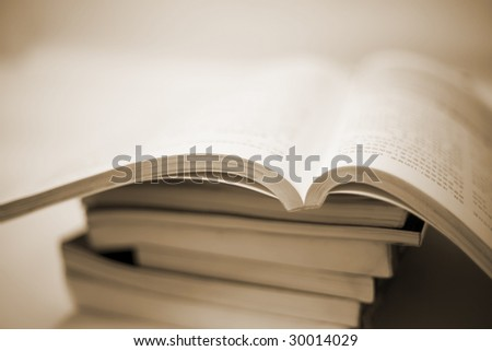 book accumulating on the white background.