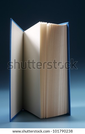 Book against blue background, close-up
