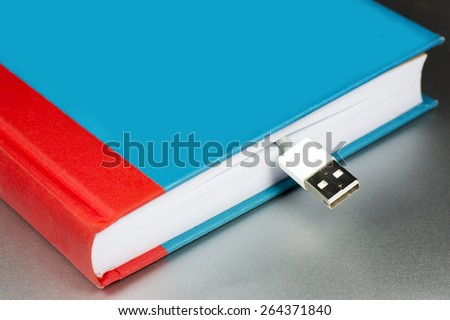book and flash drive. E-book - stock photo