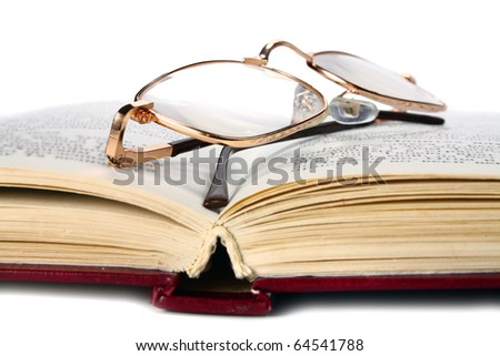 book and glasses isolated on white background - stock photo
