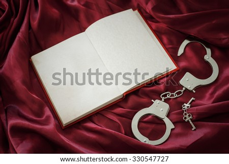 Book and handcuffs