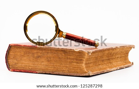book and magnifying glass isolated on white - stock photo