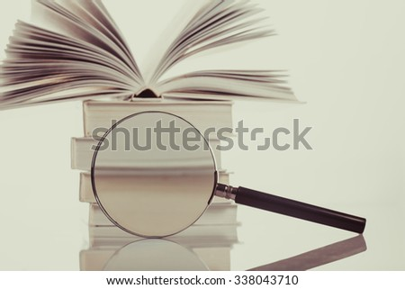 Book and magnifying glass isolated  on white. Search concept - stock photo