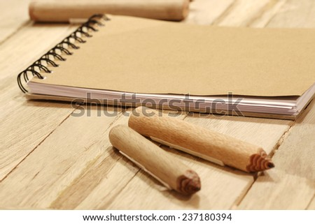book and pencil on wood table - stock photo