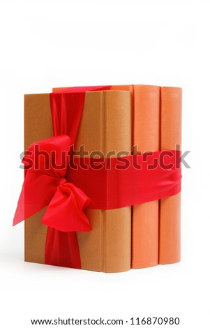 Book as a gift. A stack of books on a white background. - stock photo