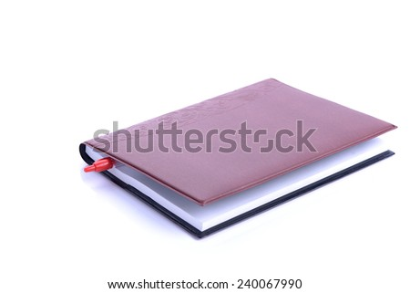 Book Bookmarked with red pen On White Background