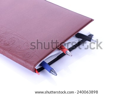 Book Bookmarked with Stationery On White Background.