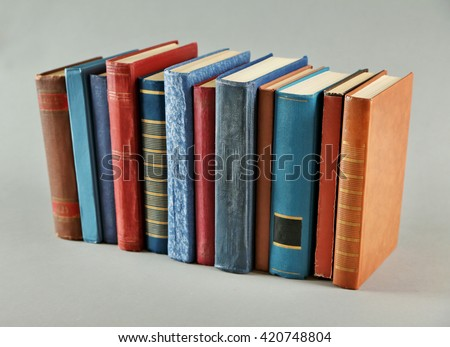 Book collection on grey background - stock photo