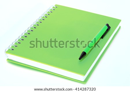 Book colorful and pen on white background - stock photo